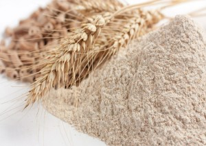 Wholemeal wheat flour and ears of wheat